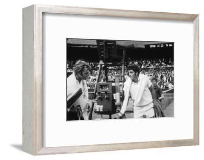 1971 Wimbledon: Australia's Rod Laver (L) and U.S.A Tom Gorman on Centre Court after their Match