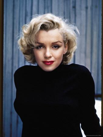 Actress Marilyn Monroe Posing at Home in Her Backyard