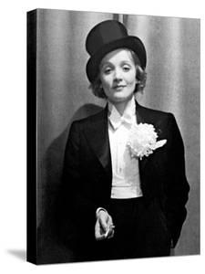 Actress Marlene Dietrich Wearing Tuxedo, Top Hat, and Holding Cigarette at Ball for Foreign Press by Alfred Eisenstaedt