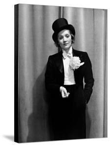 Actress Marlene Dietrich Wearing Tuxedo, Top Hat, Corsage and Holding Cigarette, Foreign Press Ball by Alfred Eisenstaedt