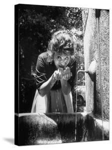 Actress Sophia Loren Drinking Water from Spigot by Alfred Eisenstaedt
