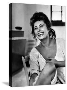 Actress Sophia Loren Laughing While Exchanging Jokes During Lunch Break on a Movie Set by Alfred Eisenstaedt