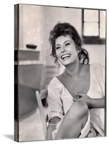 Actress Sophia Loren Laughing While Exchanging Jokes During Lunch Break on Madame Movie Set by Alfred Eisenstaedt