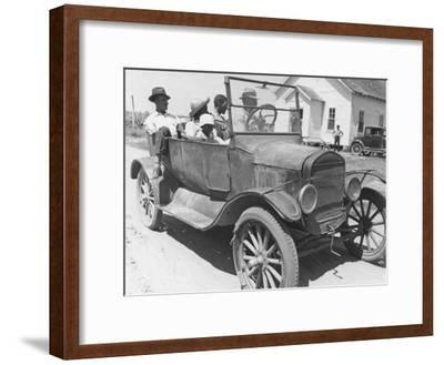 African American Men and a Boy in Dusty Jalopy in Front of Clapboard Church