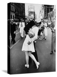 American Sailor Clutching a White-Uniformed Nurse in a Passionate Kiss in Times Square by Alfred Eisenstaedt