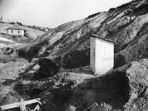 An Outhouse in an Area That Is Plagued with Soil Erosion by Alfred Eisenstaedt