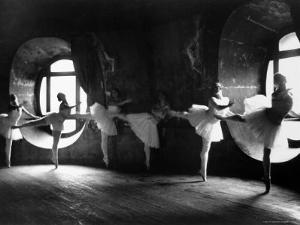 """Ballerinas at Barre Against Round Windows During Rehearsal For """"Swan Lake"""" at Grand Opera de Paris by Alfred Eisenstaedt"""
