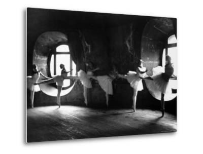 """Ballerinas at Barre Against Round Windows During Rehearsal For """"Swan Lake"""" at Grand Opera de Paris"""