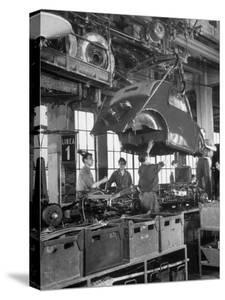 """Body Being Lowered on to """"Topolino"""" Chassis by Workers on Assembly Line at Fiat Production Plant by Alfred Eisenstaedt"""