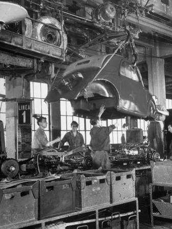 "Body Being Lowered on to ""Topolino"" Chassis by Workers on Assembly Line at Fiat Production Plant"