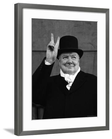 British Pm Winston Churchill Sporting Top Hat with Coat and Scarf as He Holds Up Veed Fingers