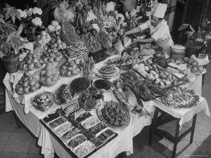 Chef Domenico Giving Final Touch to Magnificent Display of Food on Table at Passeto Restaurant by Alfred Eisenstaedt