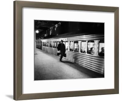 Commuter on the New York New Haven Line Running to Catch Train Pulling Out of Grand Central Station