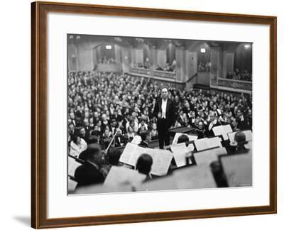 Conductor Bruno Walter Standing at Podium Conducting the Berlin Philharmonic During Performance