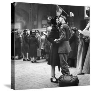 Couple in Penn Station Sharing Farewell Kiss Before He Ships Off to War During WWII by Alfred Eisenstaedt