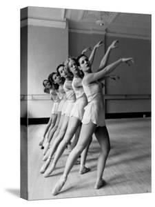 Dancers at George Balanchine's School of American Ballet During Rehearsal in Dance Posture by Alfred Eisenstaedt