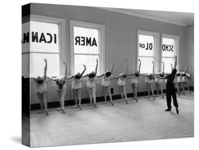 Dancers at George Balanchine's School of American Ballet Lined Up at Barre During Training