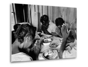 Delta and Pine Company African American Sharecropper Lonnie Fair and Family Praying before a Meal by Alfred Eisenstaedt