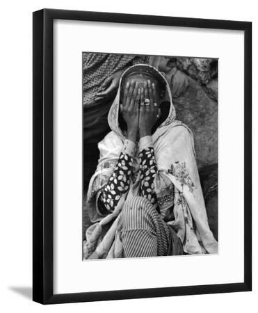 Ethiopian Woman Covering Her Face with Her Hands