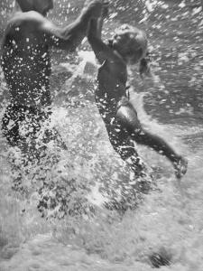 Father and Daughter Playing in the Surf at Jones Beach by Alfred Eisenstaedt