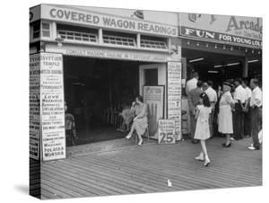 Fortune Teller Booth Next to a Penny Arcade on the Boardwalk in the Resort and Convention City by Alfred Eisenstaedt