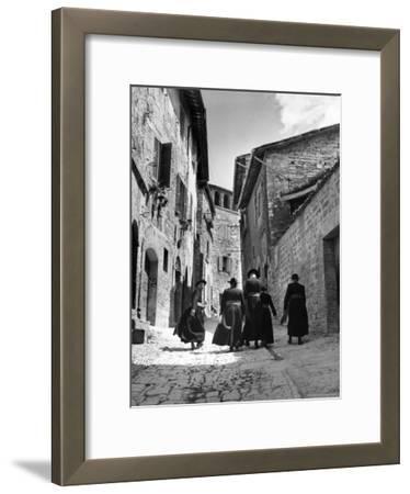 Franciscan Monks Walking Up the Via Porta Perlicinin