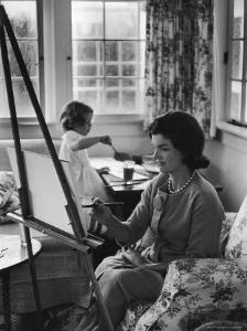 Jackie Kennedy, Wife of Sen, Painting on an easel as Daughter Caroline Paints on Table at Home by Alfred Eisenstaedt