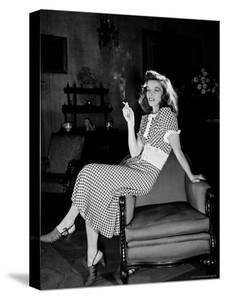 """Katharine Hepburn in chair Smoking Cigarette in Scene from Broadway Show """"The Philadelphia Story"""" by Alfred Eisenstaedt"""