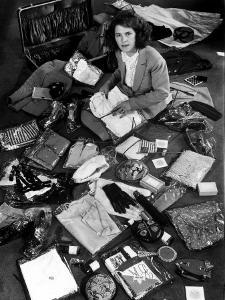 Life Photographer Margret Bourke-White Sitting Amidst Contents of Opened Suitcase by Alfred Eisenstaedt