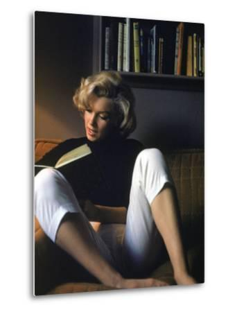 Marilyn Monroe Reading at Home