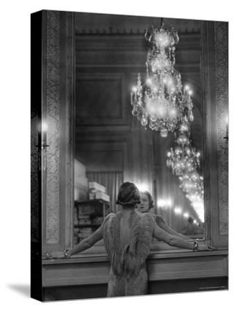 Model in Ostrich Feather Trimmed Gown Pausing to Regard Herself in Grand Mirror of Molyneux Atelier