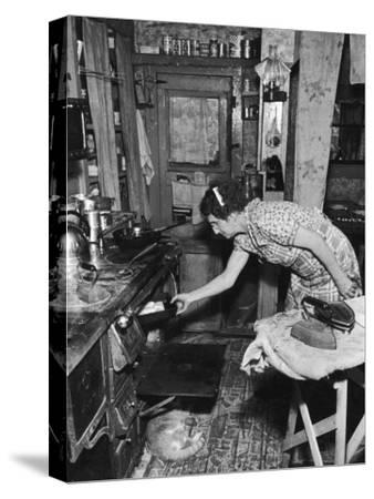 Mrs. Yandle Cooking on Coal Stove, Yacolt Mt, Future Recipients of Electricity from Bonneville Dam