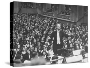 Orchestra Conductor Wilhelm Furtwangler Conducting Orchestra During a Concert by Alfred Eisenstaedt