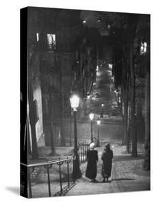 Pair of Prostitutes Descending Stairs after Dark in Montmartre by Alfred Eisenstaedt