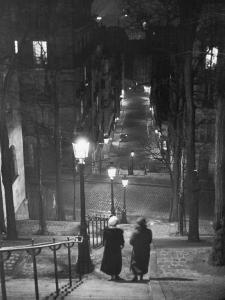 Pair of Prostitutes Descending Stairs after Dark in Montmartre by Alfred Eisenstaedt