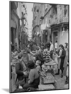 People Buying Bread in the Streets of Naples by Alfred Eisenstaedt
