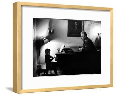 Piano Teacher Giving Lesson to Young Student in a Carnegie Hall Studio
