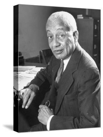 Portrait of Philosopher Alain Leroy Locke Sitting at Desk in Office at Howard University