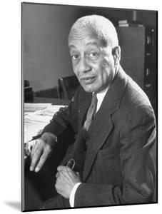 Portrait of Philosopher Alain Leroy Locke Sitting at Desk in Office at Howard University by Alfred Eisenstaedt