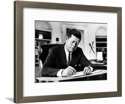 President John F. Kennedy Working at His Desk in the Oval Office of the White House