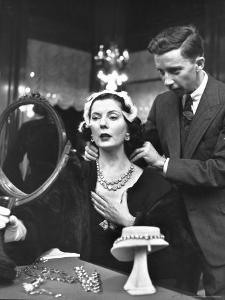 Salesman at Cartier's Showing a Diamond Necklace to Mrs. Julien Chaqueneau of New York Society by Alfred Eisenstaedt