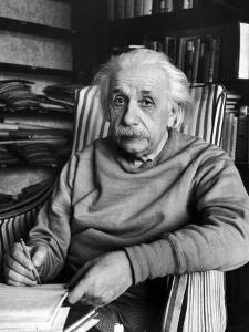 Scientist Albert Einstein Wearing Old Sweat Shirt, Sitting with Page of Equations in Home Library by Alfred Eisenstaedt