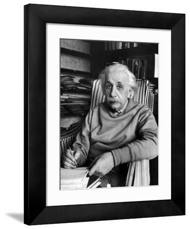 Scientist Albert Einstein Wearing Old Sweat Shirt, Sitting with Page of Equations in Home Library