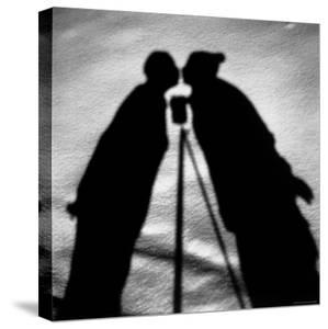 Shadows on Ground of Kissing Figures with Camera on Tripod Between by Alfred Eisenstaedt
