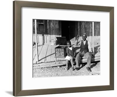 Sharecropper, Lonnie Fair and Daughter Listen to Victrola on Farm in Mississippi