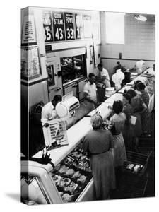 Shoppers at Butcher Counter in A&P Grocery Store by Alfred Eisenstaedt