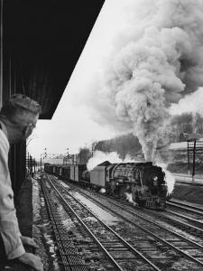 Signalman Nick Carter Watching Oncoming train at Station on the New York Central's Mohawk Division by Alfred Eisenstaedt