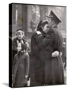 Soldier Tenderly Kissing His Girlfriend's Forehead as She Embraces Him While Saying Goodbye by Alfred Eisenstaedt