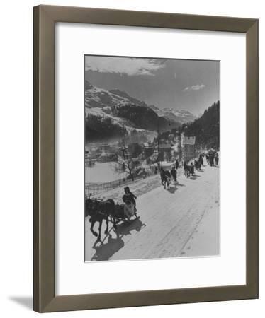 Sunday Sleigh-Rides in Snow-Covered Winter-Resort Village St. Moritz