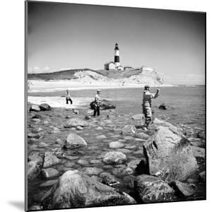 Surf Casting Fishermen Working the Shore Near the Historic Montauk Point Lighthouse by Alfred Eisenstaedt